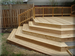 cedar deck with curved stairs