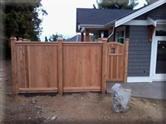 Solid fence panel with window gate